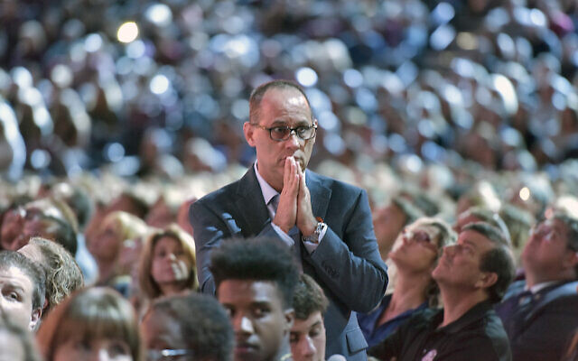 Fred Guttenberg watches a monitor honoring the 17 students and teachers who were killed at Marjory Stoneman Douglas High School, during a CNN town hall meeting in Sunrise, Florida, February 21, 2018. (Michael Laughlin/Sun Sentinel/TNS via Getty Images via JTA)