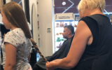 Eden had her braid measured to see if it was long enough to donate at Ophir Hashmonai's salon in Jerusalem (Jessica Steinberg/Times of Israel)