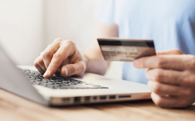 Illustrative image of a person shopping with credit card and laptop (Poike; iStock by Getty Images)