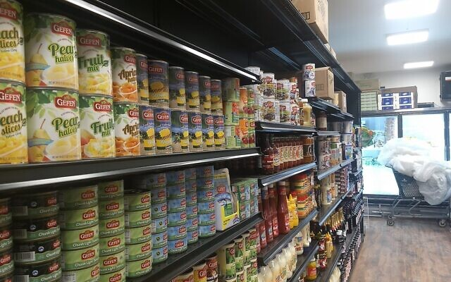 Some of JC Kosher's shelves are fully stocked with staples in its new location two blocks from the original store (Ben Sales)
