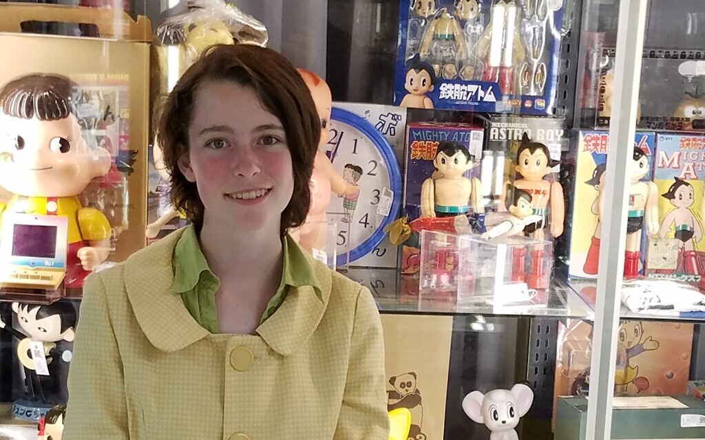 Lorelei Marcus in front of a display case full of collectibles. (Courtesy)