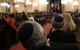An illustrative photo of people listening to a speaker at a synagogue. (Spencer Platt/Getty Images via JTA)