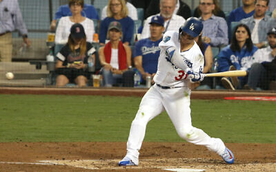 Joc Pederson of the Los Angeles Dodgers hits a third-inning homer against the Boston Red Sox in Game 3 of the 2018 World Series at Dodger Stadium in Los Angeles, October 26, 2018. (Jeff Gross/Getty Images via JTA)