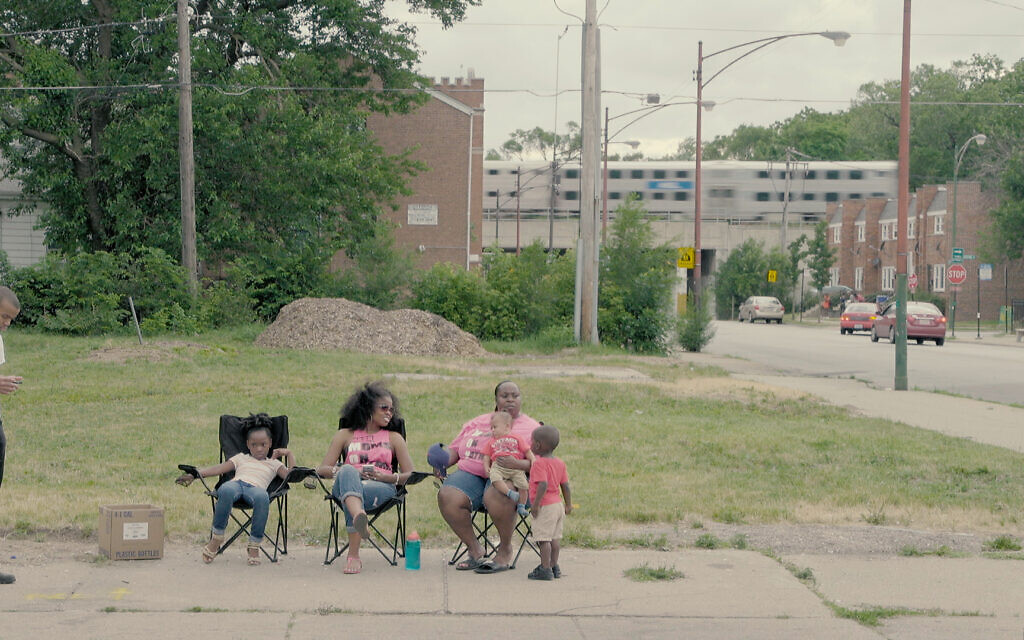 Tamar Manasseh of Mothers and Men Against Senseless Killings with others at their corner of 75th and Stewart in Chicago's south side, in a still from the new documentary 'They Ain't Ready for Me.' (Courtesy Brad Rothschild)