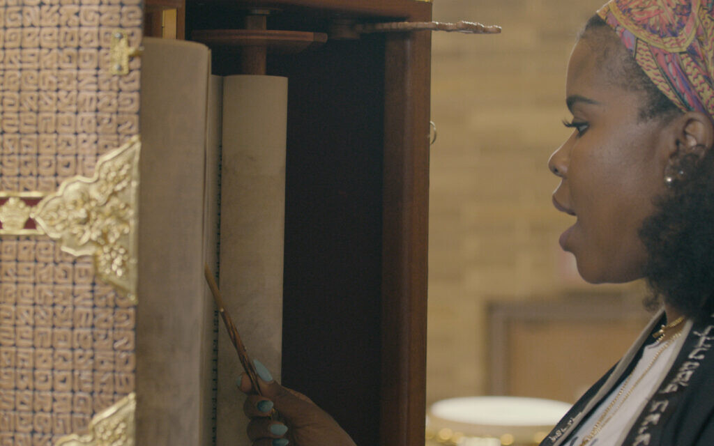 Tamar Manasseh of Mothers and Men Against Senseless Killings reads from the Torah at her temple, the Beth Shalom B'nai Zaken Ethiopian Hebrew Congregation, in a still from the new documentary 'They Ain't Ready for Me.' (Courtesy Brad Rothschild)