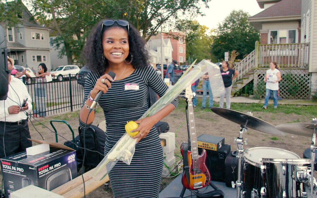 Tamar Manasseh of Mothers and Men Against Senseless Killings holds a lulav and etrog at a Sukkot celebration in Chicago's south side in a still from the new documentary 'They Ain't Ready for Me.' (Courtesy Brad Rothschild)