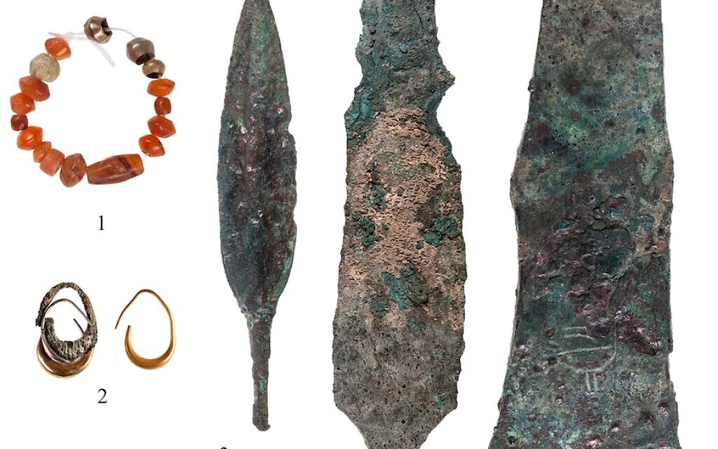 Weapons and jewelry discovered at a 12th century BCE Canaanite temple at Lachish. (T. Rogovski)