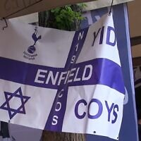 Tottenham Hotspur fans hold up a Yid sign at a soccer game (Screencapture/YouTube)