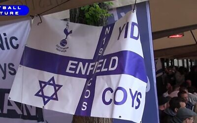 Tottenham Hotspur fans hold up a Yid sign at a soccer game. (Screen capture: YouTube)