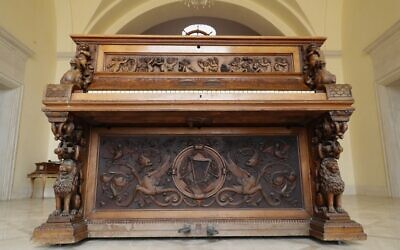 Carvings adorning the Piano of Siena, a 19th century instrument that disappeared for decades and was expected to fetch more than $1 million when put up for auction, seen in a home in the Israeli coastal city of Caesarea, February 18, 2020. (JACK GUEZ / AFP)