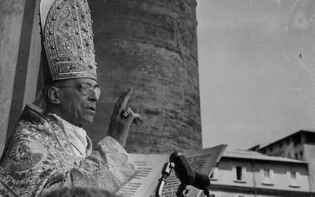 This undated photo provided by Italian news agency Ansa on February 23, 2020, shows Pope Pius XII blessing worshipers and attendees during the Urbi et Orbi apostolic blessing at St. Peter's Square in the Vatican (STRINGER / ANSA / AFP)