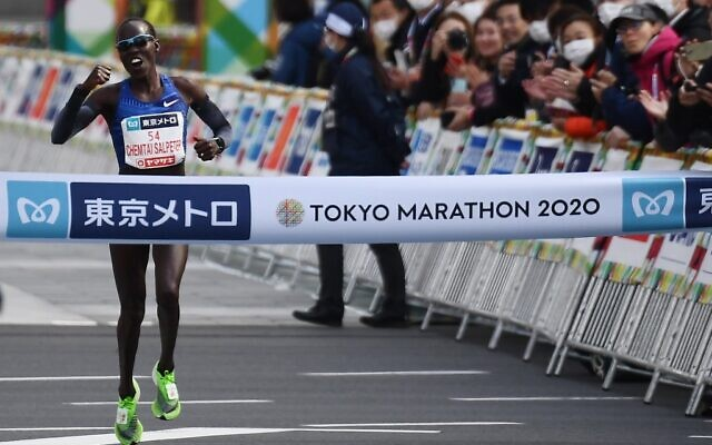 Lona Chemtai Salpeter of Israel crosses the finish line to win the women's category of the Tokyo Marathon in Tokyo on March 1, 2020. (CHARLY TRIBALLEAU / AFP)
