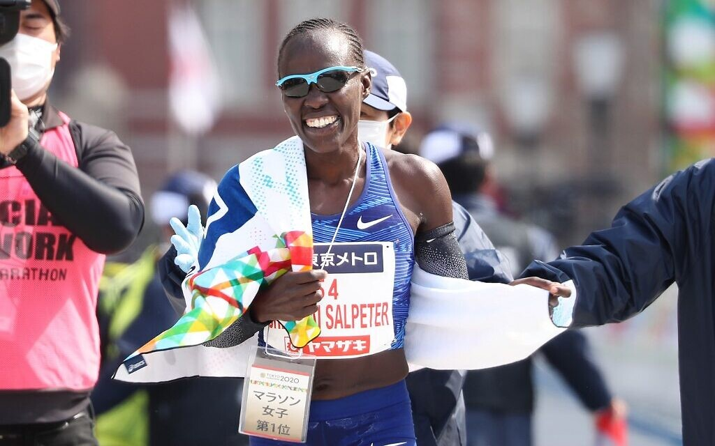 Lona Chemtai Salpeter of Israel reacts after crossing the finish line to win the women's category of the Tokyo Marathon in Tokyo on March 1, 2020. (Du Xiaoyi / POOL / AFP)