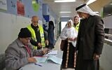 Arab Israelis cast their votes during parliamentary election in the Bedouin town of Rahat near the southern Israeli city of Beersheba on March 2, 2020 (Hazem Bader/AFP)