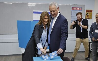 Blue and White party chief Benny Gantz and his wife Revital vote at a polling station in the city of Rosh Ha'ayin during parliamentary election on March 2, 2020 (Jack GUEZ / AFP)