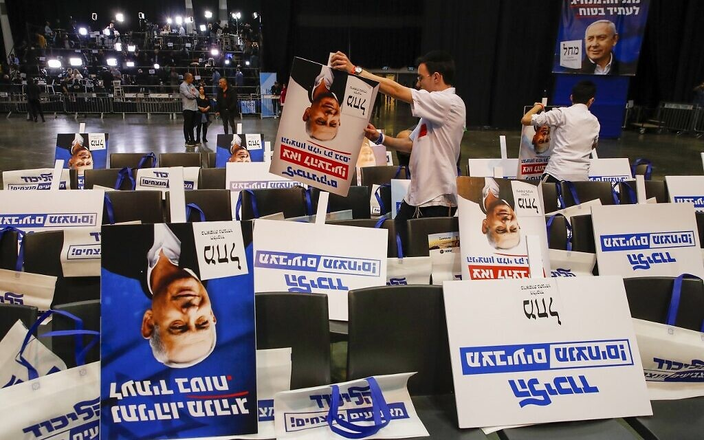 Volunteers sort election posters bearing the portrait of Prime Minister Benjamin Netanyahu, at the Likud party's electoral campaign headquarters in Tel Aviv on March 2, 2020. (Jack Guez/AFP)