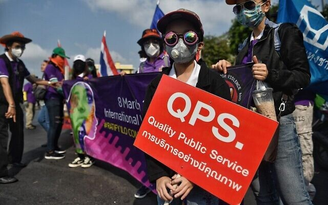 Members of Thai labour rights groups and state enterprise unions march for labour rights on International Women's Day in Bangkok on March 8, 2020. (Lillian SUWANRUMPHA / AFP)