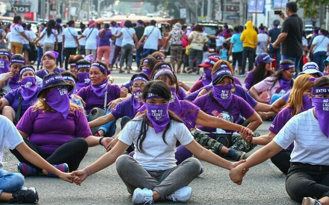 Filipino women hold a protest rally during the celebration of International Women's Day in Manila on March 8, 2020. (Maria TAN / AFP)