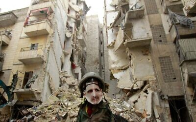 In this file photo taken on January 5, 2013, a dummy dressed up in army fatigue and a mask depicting Syrian President Bashar Assad is erected in the Salaheddine neighborhood of Aleppo, the scene of heavy fighting. (Photo by MAURICIO MORALES / AFP)