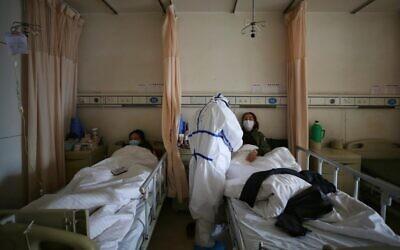 Italian daily coronavirus deaths jump 31% to 827