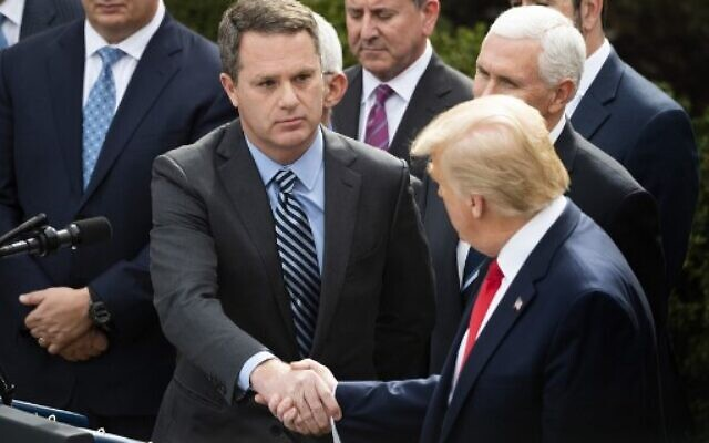 President and CEO of Walmart Inc. Doug McMillon (C) shakes hands with US President Donald Trump during press conference on COVID-19, known as the coronavirus, in the Rose Garden of the White House in Washington, DC, March 13, 2020 (JIM WATSON / AFP)