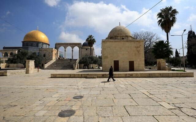 A man walks past the Dome of the Rock, in the Temple Mount compound, in the Old City of Jerusalem on March 16, 2020. (Emmanuel DUNAND/AFP)