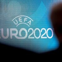 In this file photo taken on September 21, 2016 a screen displays the logo for the 2020 UEFA European Championship football tournament in London during a launch event. (JUSTIN TALLIS/AFP)