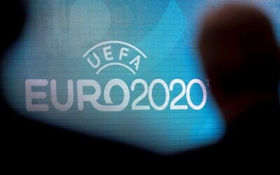 In this file photo taken on September 21, 2016 a screen displays the logo for the 2020 UEFA European Championship football tournament in London during a launch event.(JUSTIN TALLIS / AFP)