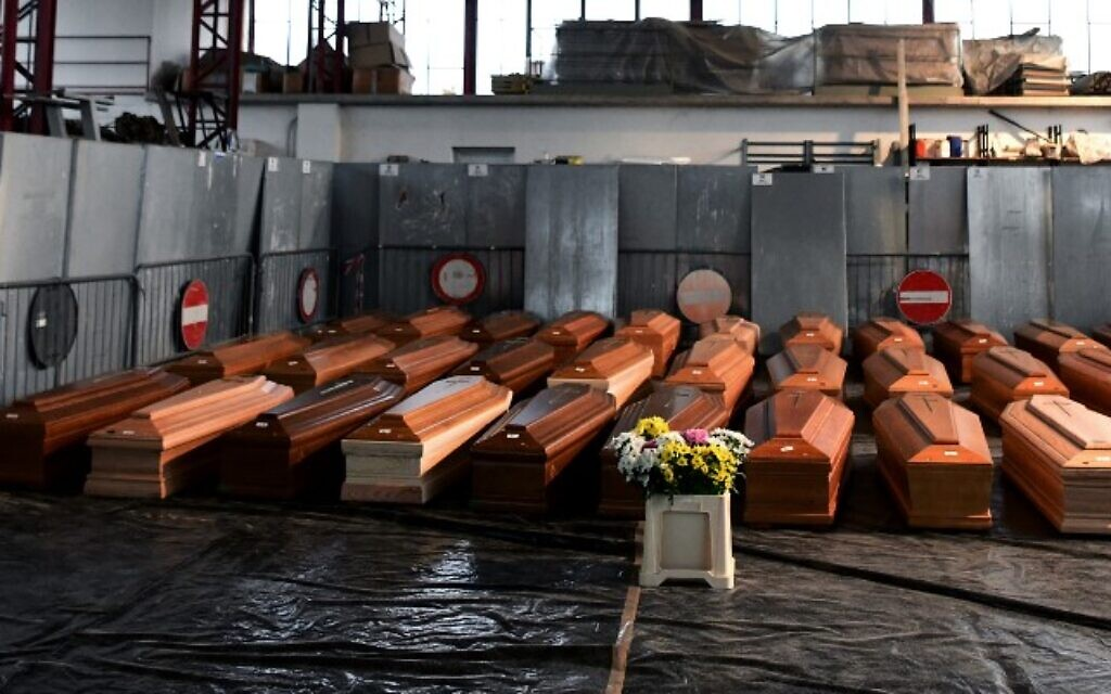 A view shows some of 35 coffins of deceased people stored in a warehouse in Ponte San Pietro, near Bergamo, Lombardy, on March 26, 2020 prior to be transported in another region to be cremated (Piero CRUCIATTI / AFP)