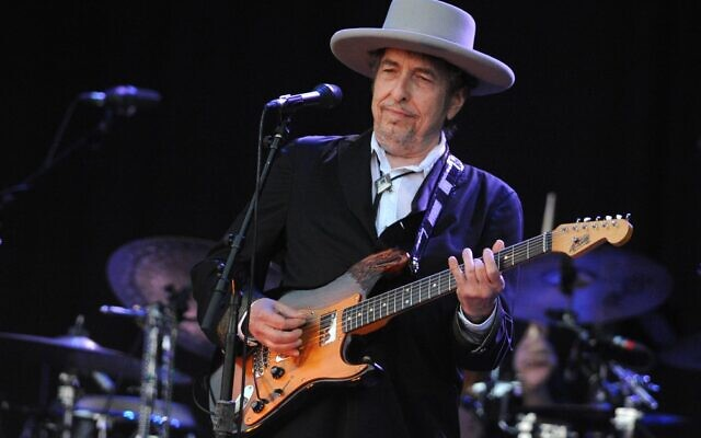 In this file photo taken on July 22, 2012, Bob Dylan performs during the 21st edition of the Vieilles Charrues music festival in Carhaix-Plouguer, western France (Fred TANNEAU / AFP)