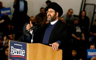 Imam Al-Hasan Qazwini from the Islamic Institute of America, speaks during a campaign rally for Democratic presidential hopeful Bernie Sanders at Salina Intermediate School in Dearborn, Michigan, on March 7, 2020. (JEFF KOWALSKY/AFP via Getty Images via JTA)