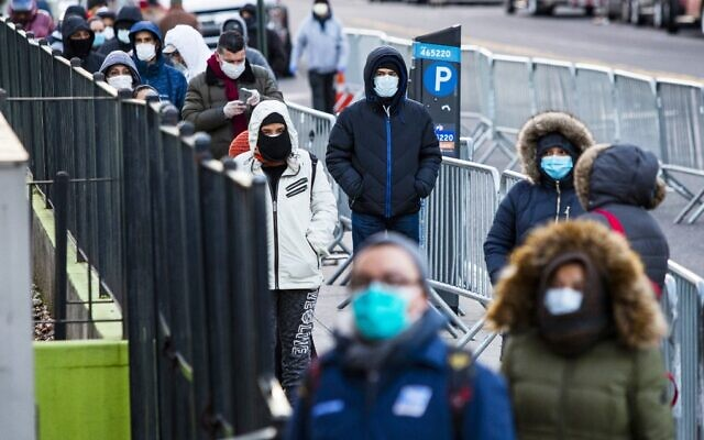 People line up to get a test at Elmhurst Hospital amid the coronavirus outbreak on March 24, 2020, in Queens, New York. (Eduardo Munoz Alvarez/Getty Images/AFP)