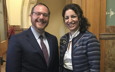 Rabbi Yehiel Kalish (L) attends the swearing-in of Dafna Michaelson Jenet, his sister, at the Colorado House of Representatives in Denver, Janurary 11, 2017. (Courtesy of Michaelson Jenet)