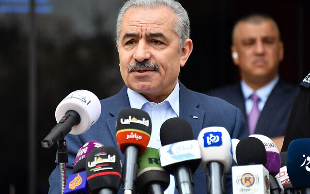 Palestinian Authority Prime Minister Mohammed Shtayyeh announcing a series of measures, which he said aim to prevent the spread of the novel coronavirus in Ramallah on March 22, 2020. (Credit: Wafa)