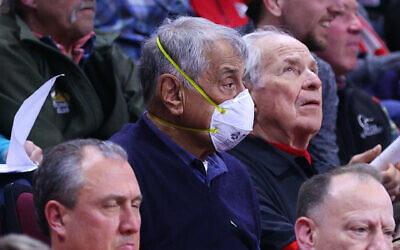 A fan wears a mask to protect against the coronavirus during the Big 10 wrestling championships at the Rutgers Athletic Center in Piscataway, New Jersey, March 7, 2020. (Rich Graessle/Icon Sportswire via Getty Images via JTA)