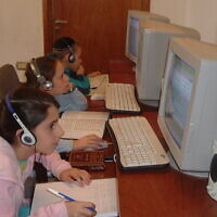 Chabad children in Argentina study in the movement's online school in 2007. During the new coronavirus outbreak, the school has offered guidance to other Jewish schools transitioning to remote learning. (Courtesy of the Nigri International Shluchim Online School/ via JTA)