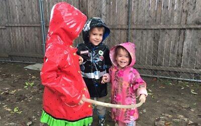 Kids at the Chabad-run preschool in Burlington, Vermont, play in the yard. (Courtesy of Draizy Junik/ via JTA)