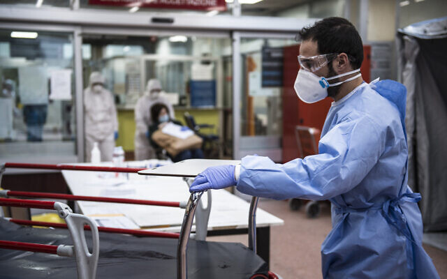 Medical personnel in protective suits await the arrival of possible COVID-19 infections in the Molinette Hospital lobby in Turin, Italy, March 26, 2020. (Stefano Guidi/Getty Images/ via JTA)