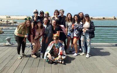 URJ Heller High students in Tel Aviv, shown dressed up in Purim costumes, are all being flown home to the U.S. (URJ Heller High/Facebook via JTA)