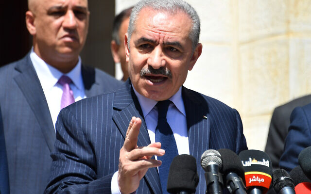 Palestinian Authority Prime Minister Mohammed Shtayyeh addressing a press conference in Ramallah on March 29, 2020. (Wafa)