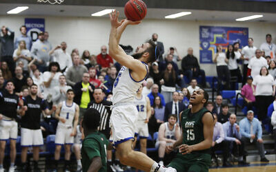 Maccabees guard Eitan Halpert (15) jumps for a layup in the second half of the Skyline Conference semifinal game against Farmingdale State College at Yeshiva University in New York, Feb. 27, 2020. Yeshiva won 74-69, advancing to the championship game against Purchase College. (AP Photo/Jessie Wardarski)
