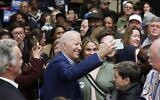 Democratic presidential candidate former US Vice President Joe Biden takes photos with supporters at a campaign event at Saint Augustine's University in Raleigh, North Carolina, February 29, 2020. (AP Photo/Gerry Broome)
