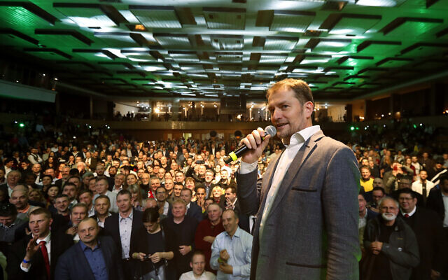 Leader of the Ordinary People and Independent Personalities party Igor Matovic addresses his supporters, acknowledging preliminary results of the general election in Trnava, Slovakia on March 1, 2020. (AP/Petr David Josek)