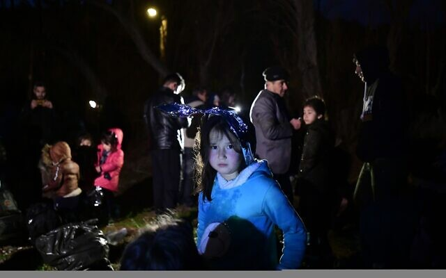 Migrants arrive at the village of Skala Sikaminias, on the Greek island of Lesbos, after crossing on a dinghy the Aegean sea from Turkey, March 1, 2020. (Michael Varaklas/AP)