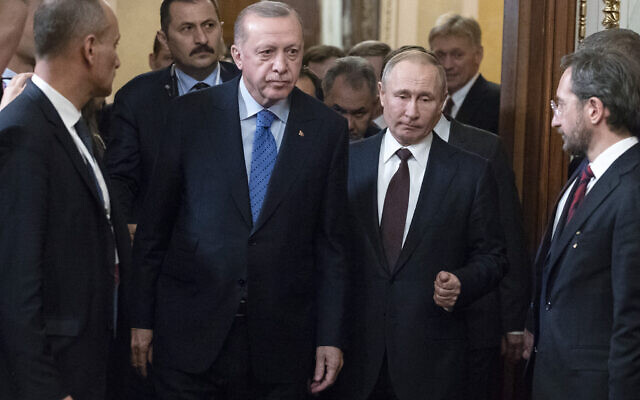 Russian President Vladimir Putin, center right, and Turkish President Recep Tayyip Erdogan, center left, arrive for a news conference after their talks in the Kremlin, in Moscow, Russia, Thursday, March 5, 2020. Russian President Vladimir Putin and his Turkish counterpart, Recep Tayyip Erdogan, say they have reached agreements that could end fighting in northwestern Syria. (AP Photo/Pavel Golovkin, Pool)