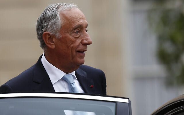 In this July 14, 2019 photo, Portugal's President Marcelo Rebelo de Sousa leaves after a lunch at the Elysee Palace that followed Bastille Day parade on the Champs-Elysees avenue in Paris. (AP Photo/Kamil Zihnioglu, File)