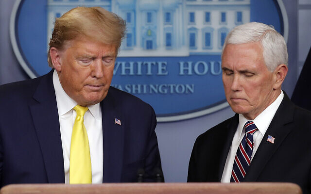 US President Donald Trump steps from the podium to allow Vice President Mike Pence to speak in the briefing room of the White House in Washington, March, 9, 2020, about the coronavirus outbreak. (AP Photo/Carolyn Kaster)