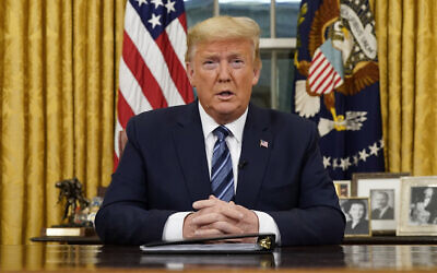 US President Donald Trump speaks in an address to the nation from the Oval Office at the White House about the coronavirus Wednesday, March, 11, 2020, in Washington. (Doug Mills/The New York Times via AP, Pool)