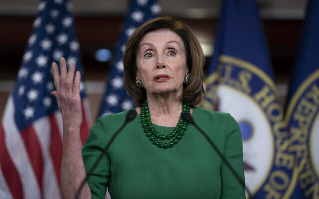 Speaker of the House Nancy Pelosi, Democrat-California, updates reporters as lawmakers continue work on a coronavirus aid package, on Capitol Hill in Washington, March 12, 2020. (AP Photo/J. Scott Applewhite)