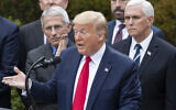 US President Donald Trump, accompanied by Dr. Anthony Fauci, director of the National Institute of Allergy and Infectious Diseases, left, and Vice President Mike Pence, right, speaks during a news conference about the coronavirus in the Rose Garden at the White House, Friday, March 13, 2020, in Washington. (AP/Alex Brandon)